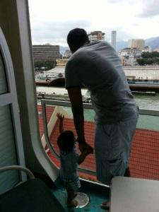 The boys watching the ship dock at Penang