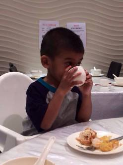 Having a taste of his first chrysanthemum tea