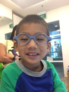Trying out his new glasses for the first time