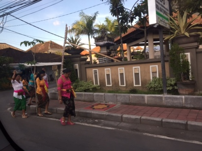 Locals all dressed up on Nyepi Eve while we were in search for any food place that was opened..