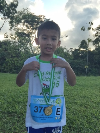 Jah with his first medal...a moment worth documenting
