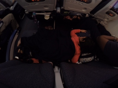 2nd kid napping!! This was after I successfully transferred her from my carrier to the plane seat..