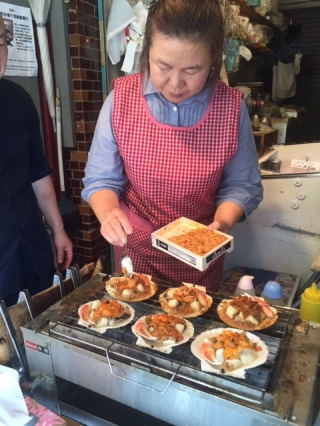 Aunty adding uni to our scallops! There were crab claws in there too!