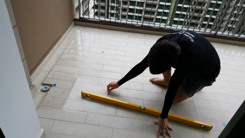 Checking floor level and uneveness in wet areas.jpeg